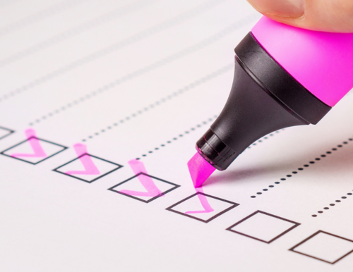 a check list for documents with a pink highlighter