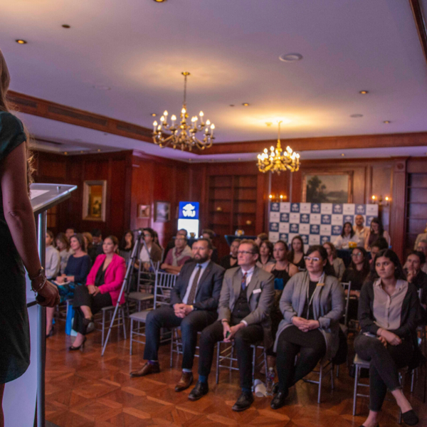 A woman making a presentation at a hotel venue