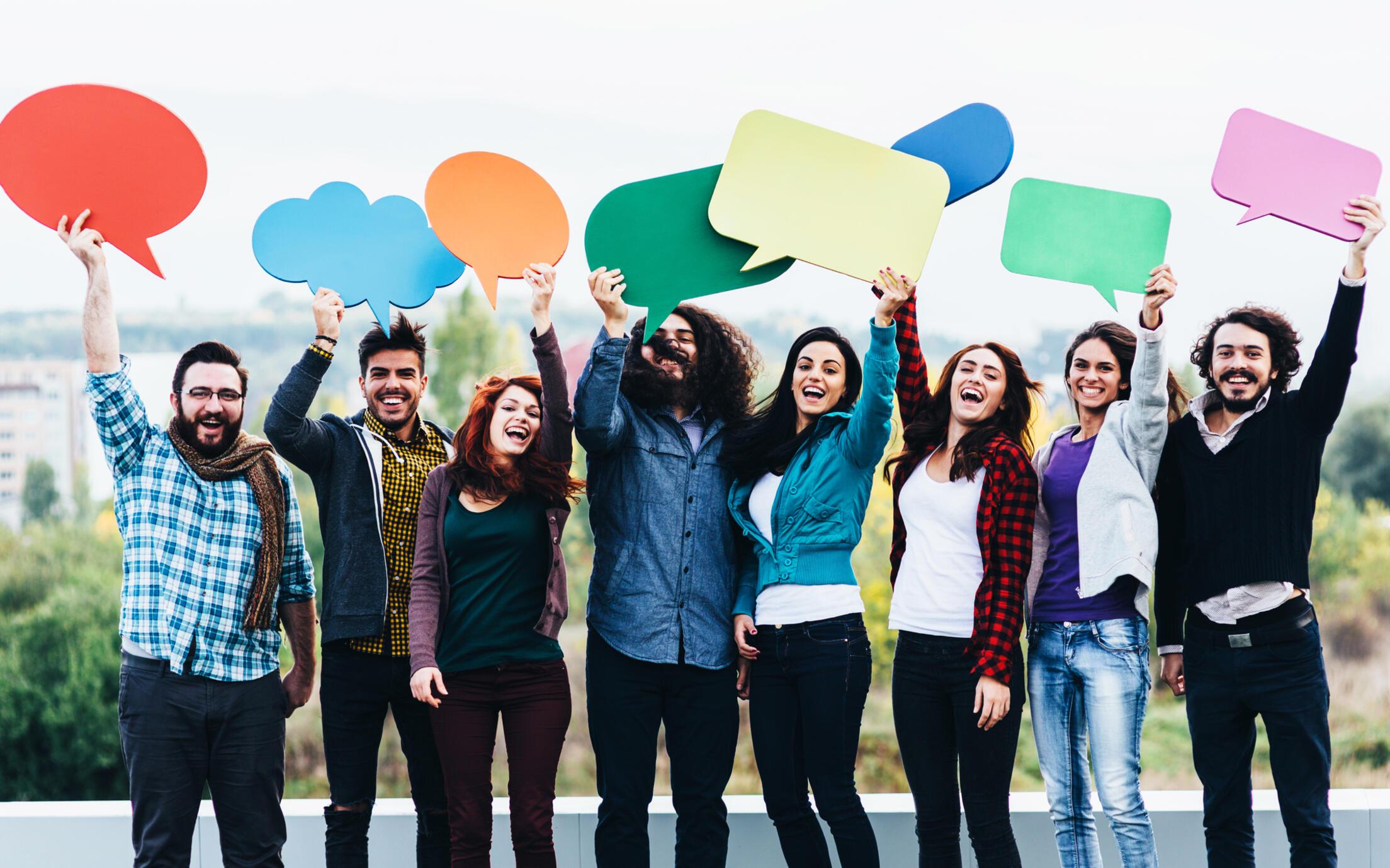 People holding speech bubbles