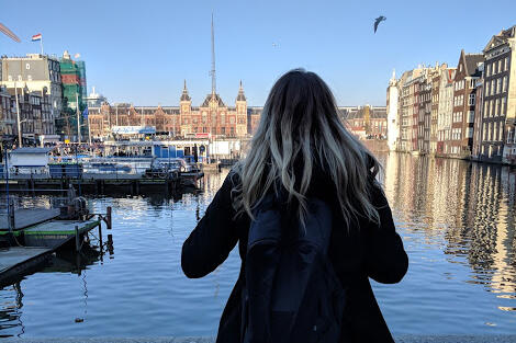 Student overlooking canal