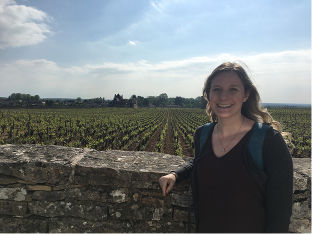 Student in front of vineyard